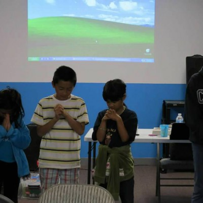 Children praying at the Good News Club (every Friday at 7:30 pm at Chinese Community Church of South Bay)